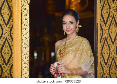 Beautiful Thai girl in traditional dress costume in Choeng Tha as Thailand temple