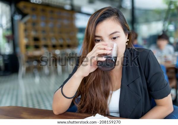 beautiful thai woman drinking coke