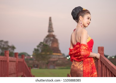 Beautiful Thai woman in traditional costume of Thailand at historical park
