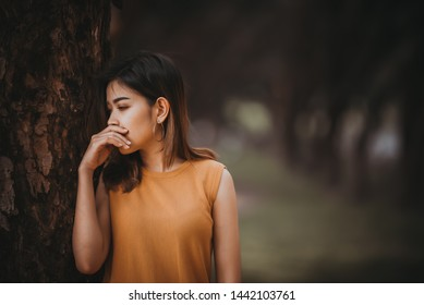 Beautiful thai woman very sad from unrequited love,Broken heart woman concept,Thailand people,Portrait of sad woman
