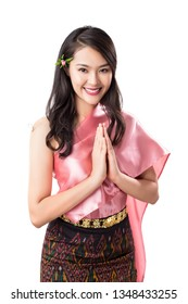Beautiful Thai woman wearing traditional Thai costume and doing welcome expression Sawasdee, isolated on white background.