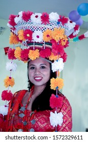 Beautiful Tharu model from Nepal with cultural attire, red dress, traditional values, Nepali model