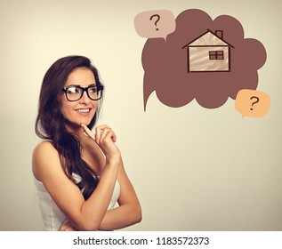 Beautiful thinking business woman in glasses looking on illustration house in bubble above with questions. Insurance protection concept, investment to safety money. Vintage color style
