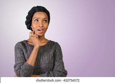 Beautiful thoughtful black woman looking up