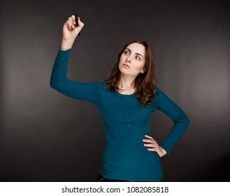 Beautiful thoughtful businesswoman holding a marker on her hands