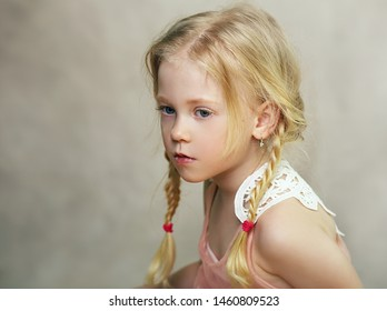 beautiful thoughtful little girl studio portrait