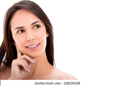 Beautiful thoughtful woman - isolated over a white background