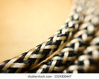 Beautiful three braided line on the brown background with copy space, Close up, Selective focus.