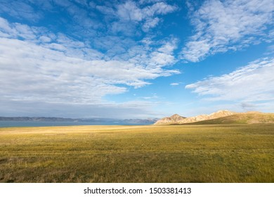 beautiful three river sources nature reserve landscape, grassy plateau and lake against a blue sky, qinghai province, China