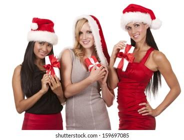 beautiful three women wearing christmas hats on white background