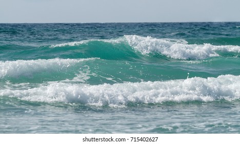 Beautiful tidal waves against the sky. Seascape.