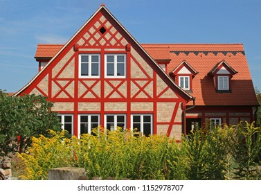 beautiful timbered house with red beams in construction, render still missing