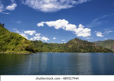 beautiful toba lake , with a background of blue sky with clouds and mountains,north Sumatra,indonesia