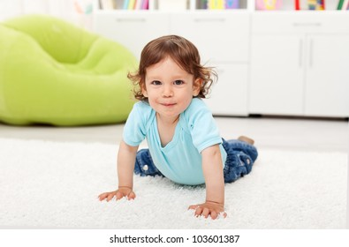 Beautiful toddler child - playing on the floor at home