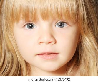 Beautiful toddler looking at the camera