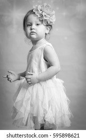 Beautiful toddler poses with her Easter dress