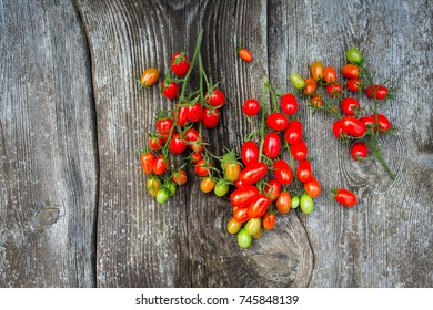 beautiful tomatoes on wooden surface