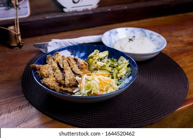 beautiful tonkatsu dish. Tonkatsu is a Japanese dish that consists of a breaded, deep-fried pork cutlet serving with Japanese Worcestershire sauce, rice, and vegetable salad.