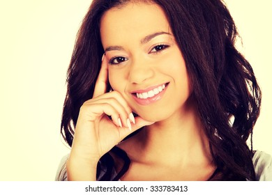 Beautiful toothy smiling thoughtful woman.