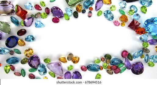 Beautiful topaz,amethyst,tourmaline,citrine,blue sapphire,garnet,emerald,ruby,yellow sapphire,gemstone,isolated on white