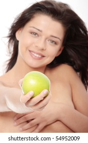 Beautiful topless girl with green apple, isolated on white background