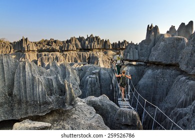 Beautiful tourist on an excursion in the unique limestone landscape at the Tsingy de Bemaraha Strict Nature Reserve in Madagascar
