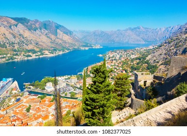 Beautiful town of Kotor in Montenegro. Panoramic aerial view of Kotor and Boka Kotorska bay on Adriatic sea in summer sunny day. Old part of city Kotor is protected by UNESCO. Horizontal Wallpaper