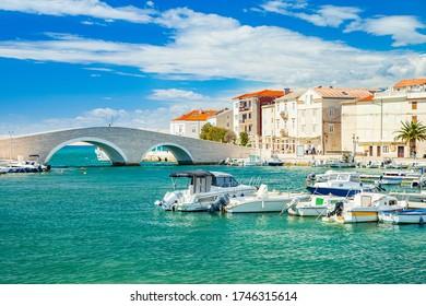Beautiful town of Pag on Adriatic sea in Dalmatia, Croatia, old stone bridge, waterfront and marina with boats