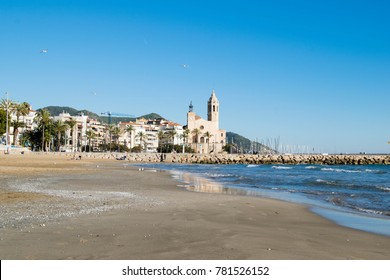 The beautiful town of Sitges with seagulls, winter Spain, Landscape of the coastline in Sitges, Parròquia de Sant Bartomeu i Santa Tecla