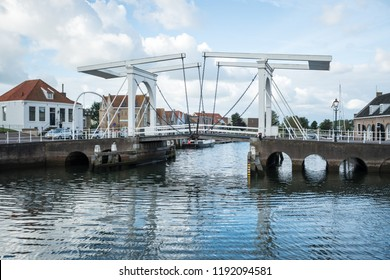 in the beautiful town of Zierikzee by the sea there is a very old south port gate building whit his lift bridge