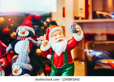 Beautiful toy figure of modern Santa Claus taking a selfie