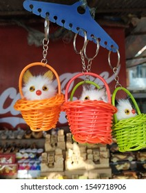 a beautiful toys key chains for locks. it is amazing key chain with small dog and basket decaration. colourful keychains.