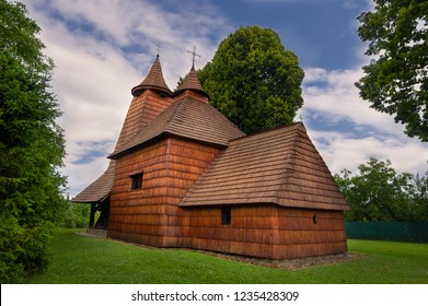 Beautiful traditional historical carpathian wooden church in Trocany near Bardejov in Slovakia, part of Unesco world heritage in natural surrounding of green grass and trees
