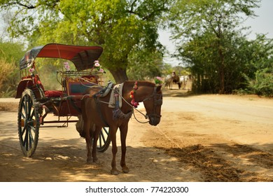 Beautiful traditional horse cart, tourist taxi, standing on dirt road in Bagan, Myanmar (Burma)