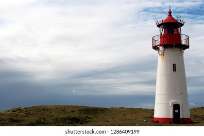 Beautiful traditional lighthous at the island sylt germany, guiding the ships through the night at the north sea