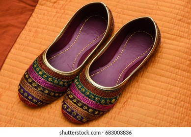 Beautiful traditional multi color design party wear Rajasthani Mojari or shoes worn by ladies, women Jaipur, Rajasthan India. Made from leather
