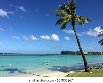beautiful tranquil and idyllic white sand beach for relax in Guam island, USA. Guam beach white sand view of crystal clear turquoise sea water and palm. Summer holiday relax on Paradise beach Guam
