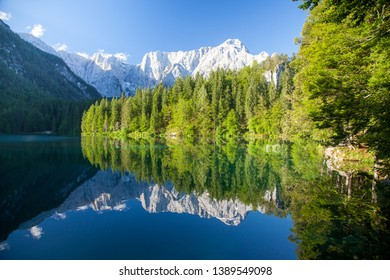Beautiful tranquil morning view of famous Laghi di Fusinee in scenic morning light at sunrise, province of Udine, Friuli-Venezia Giulia, northern Italy