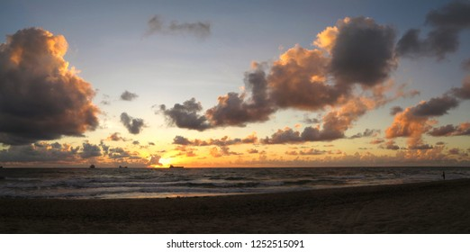 A beautiful tranquil sunrise brings dawn to the Fort Lauderdale beach.  Usually a bustling tourist attraction, at this hour the beach is incredibly peaceful.