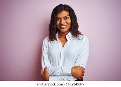 Beautiful transsexual transgender elegant businesswoman over isolated pink background happy face smiling with crossed arms looking at the camera. Positive person.