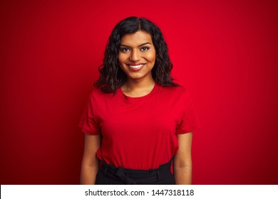 Beautiful transsexual transgender woman wearing t-shirt over isolated red background with a happy and cool smile on face. Lucky person.