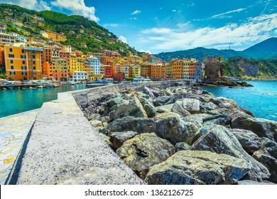 Beautiful travel destination, sea wall with mediterranean harbor and colorful buildings, Camogli, Liguria, Italy, Europe