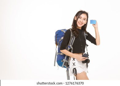 Beautiful travel girl with credit card isolated on white background