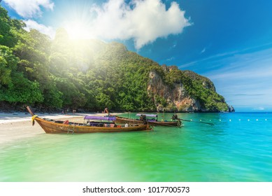 Beautiful travel scene with traditional boat on Monchy beach on the coast of Phi Phi region in Thailand island
