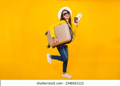 Beautiful traveler asian woman with camera and luggage isolated on yellow background ,summer,travel concept.