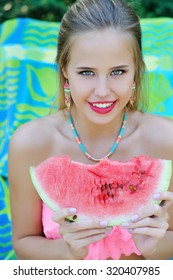 Beautiful trendy woman portrait with watermelon, healthy diet concept