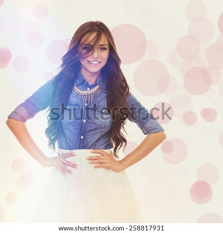 2e314c7ed65ff Beautiful trendy young woman with long hair. Gorgeous brunette girl in  denim shirt and white skirt laughing and posing. Retouched