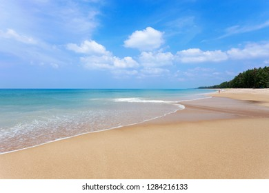 Beautiful Tropical beach andaman sea and clear blue sky background,in phuket island,Summer beach with wave crashing on sandy shore landscape travel and tour concept.