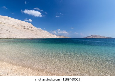 Beautiful tropical beach blue water white mountains