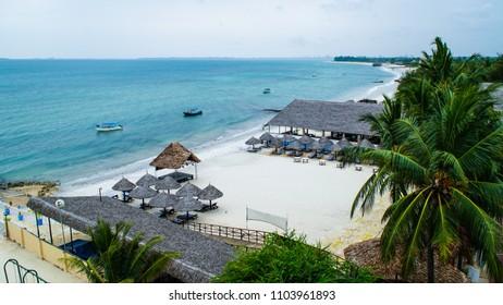 Beautiful tropical beach front hotel resort with swimming pool, Bahari Beach in Dar es Salaam, Tanzania, circa December 2017